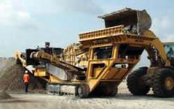 Photo of a concrete crusher in action