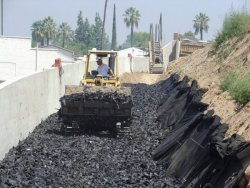 Photo of equiment installing lightweight backfill