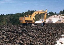 Photo: Construction equipment placing  tire shreds during road construction